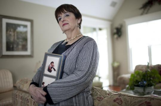 Jeannine Boulanger, with a photo of her daughter Nicole, who died on the 1988 flight that exploded over Lockerbie, Scotland.