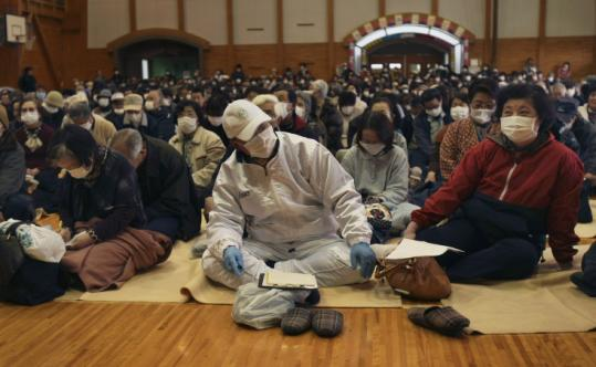 Residents on the outskirts of Fukushima crowded into a school gymnasium for a meeting on the impact of radiation exposure.