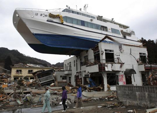 A boat still rested on a building yesterday after the March 11 earthquake and tsunami that struck off the coast of Japan.