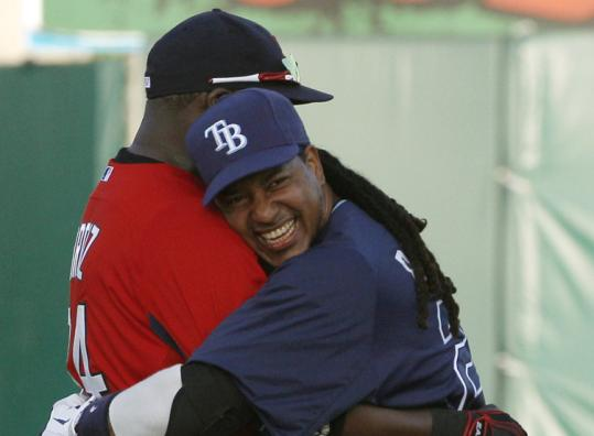Red Sox DH David Ortiz is embraced before last night's game by ex-teammate Manny Ramirez, now a member of the Rays.