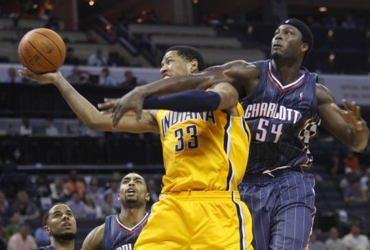 Pacers' Danny Granger (33) is fouled by Kwame Brown, but it did the Bobcats no good as they couldn't slow Indiana at home.