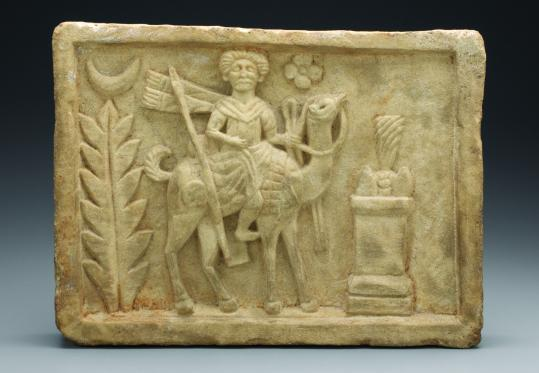 A limestone panel from the temple of Adonis at Dura-Europos is on view in an exhibit at Boston College's McMullen Museum of Art.
