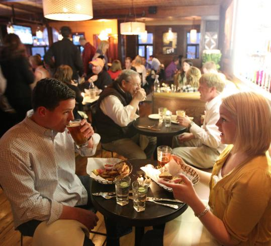 Devin Mackie and Jen Moody, both of South Boston, enjoy a meal at new neighborhood restaurant Local 149.
