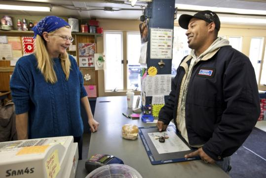 Business is good at Upton's lone grocery store, the Country Sooper, where cashier Alaina Bigelow helped Justin Harden.