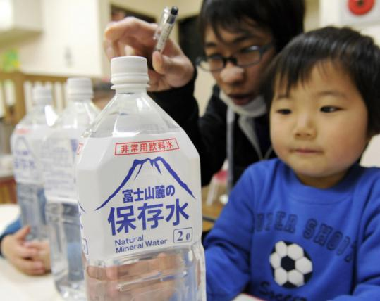Officials distributed bottled water for an estimated 80,000 children under the age of 1 in the Tokyo area yesterday.