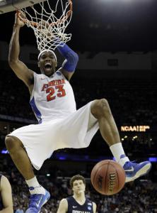 Florida's Alex Tyus finishes off a resounding dunk in overtime as BYU's Jimmy Fredette looks on during the Gators' victory. Tyus had 19 points and 17 rebounds to lead the charge for Florida.