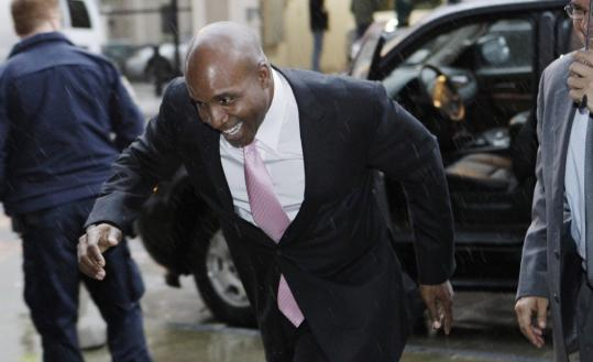 Home run king Barry Bonds arrives at a federal courthouse in San Francisco as testimony continued in his trial on perjury charges. It will resume on Monday.