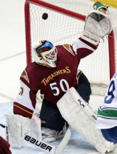 Thrashers goalie Chris Mason failed to get any leather on this second-period shot by the Canucks' Alex Bolduc.