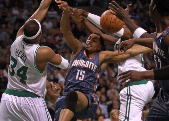Gerald Henderson ventures into the paint and is roughed up by Paul Pierce (left) and Jeff Green.