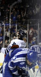 Air Force's Adam McKenzie reacts after Chad Ziegler (background) scored in OT.