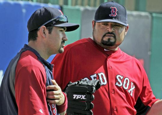 Lefthander Dennys Reyes (right, with Adrian Gonzalez) has impressed his manager this spring.