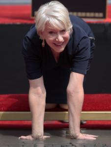 HANDS DOWN: British actress Helen Mirren adds her handprints to the cement yesterday at Grauman's Chinese Theatre in Los Angeles.