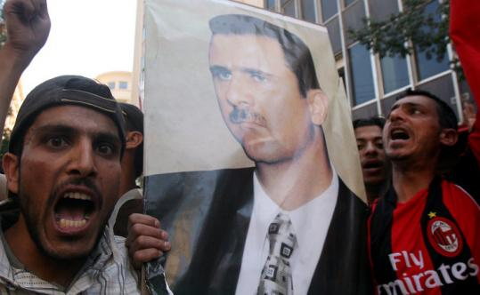 Syrian laborers chanted slogans of support for their president, Bashar Assad, outside the Syrian Embassy in Beirut.