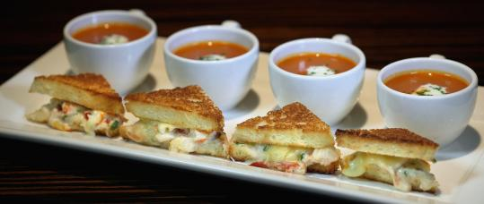 At 94 Mass Ave, lobster grilled cheese sandwiches are served with mini-teacups of lobster-tomato bisque.