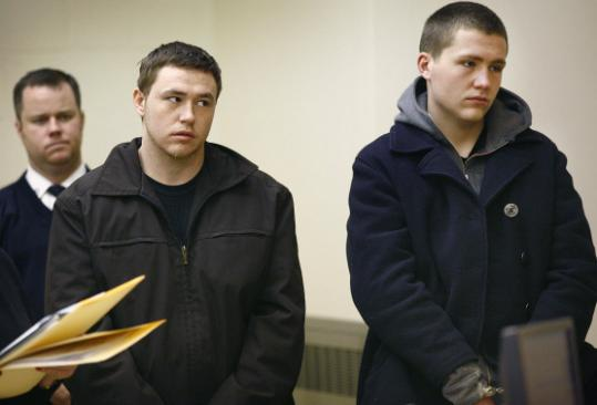 Christopher Babij (left) and his brother, Kenneth, in Quincy District Court yesterday.