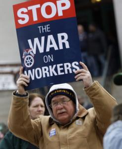 Larry Cerne of Cleveland protested against the collective bargaining bill yesterday.