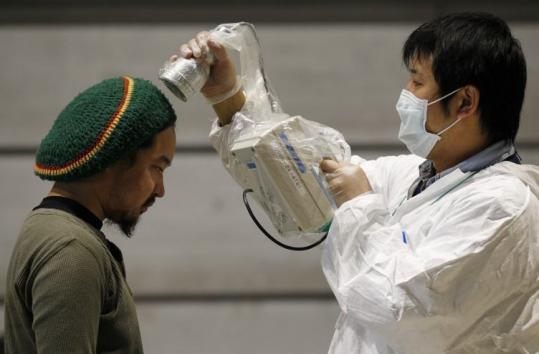 A man was tested yesterday for radiation exposure in northern Japan, 44 miles from the tsunami-crippled nuclear reactor.