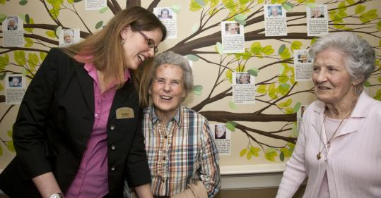 Artist Heather Harmon laughs with residents Ann Butterfield (center) and Claire Allen.