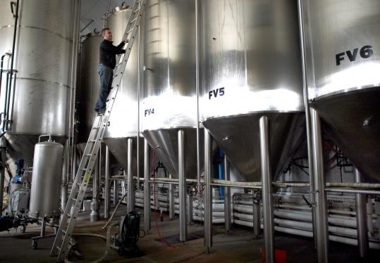 Brewer and cofounder Dann Paquette, at work at the Pretty Things Beer and Ale Project's Westport brewery, has beaten the odds.