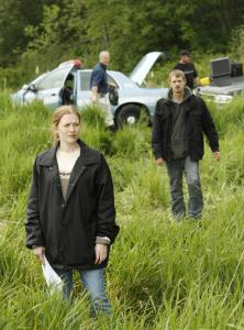 "Mireille Enos is detective Sarah Linden and Joel Kinnaman is her partner, Stephen Holder, trying to solve a murder case in the new AMC series, ""The Killing.''"