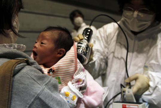 Nagashima Rio, who was born on March 15, was tested for radiation contamination at an evacuation center in Koriyama, Fukushima Prefecture, in northern Japan. She was born at a hospital located about 30 miles from the damaged nuclear plant.