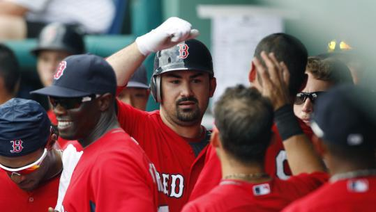 Teammates congratulated prized Red Sox acquisition Adrian Gonzalez following a preseason home run on Tuesday.