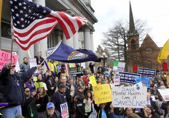 Demonstrators rallied on the steps of New Hampshire's State House yesterday to protest proposed spending cuts and a provision that would strip public employees of union protection.