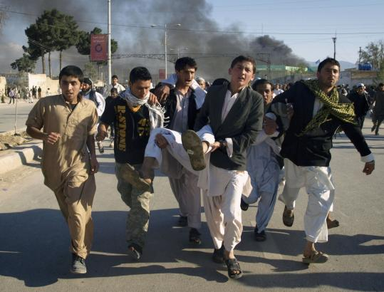 Men carried a comrade wounded in an attack on the United Nations office in Mazar-e-Sharif, Afghanistan.