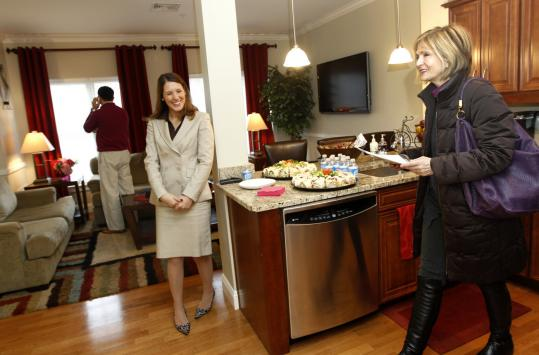Katie Swenson (left), an associate with Hammond Residential Real Estate, shows realtor Amy Surman of Keller Williams Realty, a condo unit at 35 Commonwealth Ave. during an open house for brokers.