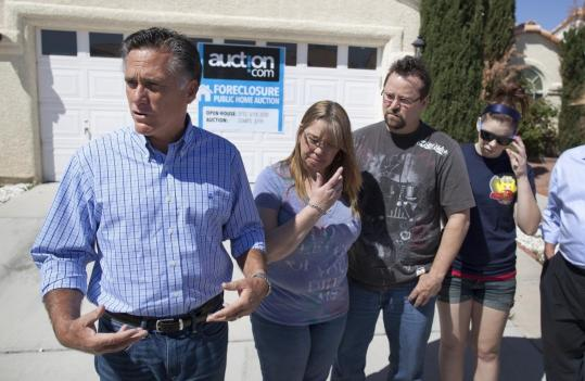 Potential presidential candidate Mitt Romney spoke with reporters after touring a Las Vegas neighborhood hit hard by foreclosures. Next to him were Kathy and Dave Tyler and their daughter Allie.