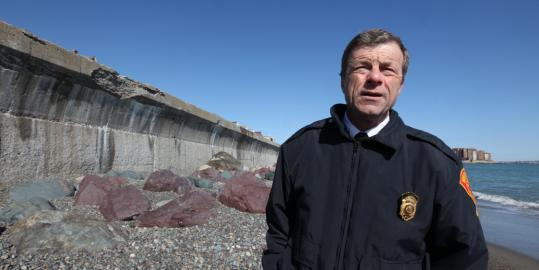 &#8220;This sea wall&#8217;s done,&#8217;&#8217; said Winthrop Fire Chief Paul Flanagan as he toured Winthrop Beach.
