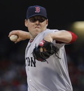 John Lackey allowed nine runs on 10 hits, earning the loss as the Red Sox dropped to 0-2 for the first time since 2005.