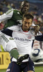 The Revolution's A.J. Soares can't keep Portland's Brian Umony from the ball in the second half.