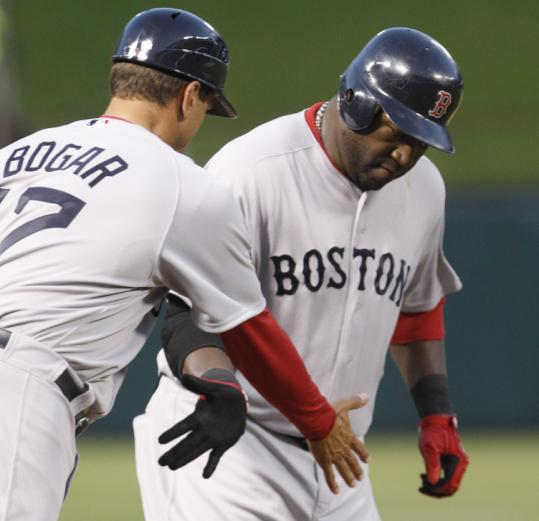 David Ortiz gets a hand after he slugged a two-run home run in the second inning to give the Red Sox a brief 2-1 lead.
