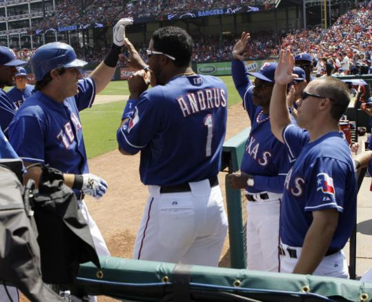 Ian Kinsler is congratulated by teammates following his solo home run off Clay Buchholz in the third inning yesterday.