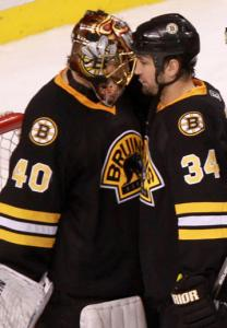 Returnee Shane Hnidy congratulates goalie Tuukka Rask after Saturday's win.