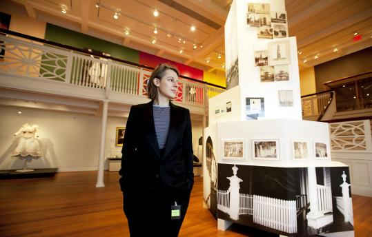 "Marianne Mueller, a conceptual artist and photographer from Switzerland, amid her exhibit, ""Any House Is a Home,'' at the Peabody Essex Museum in Salem."