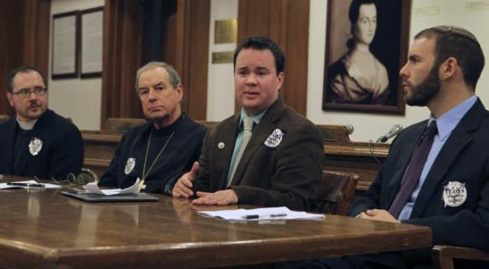 From left, the Rev. Cameron Partridge, Episcopal Bishop M. Thomas Shaw, the Rev. Sean Delmore, and Rabbi Joseph Berman spoke yesterday on transgender-rights legislation.
