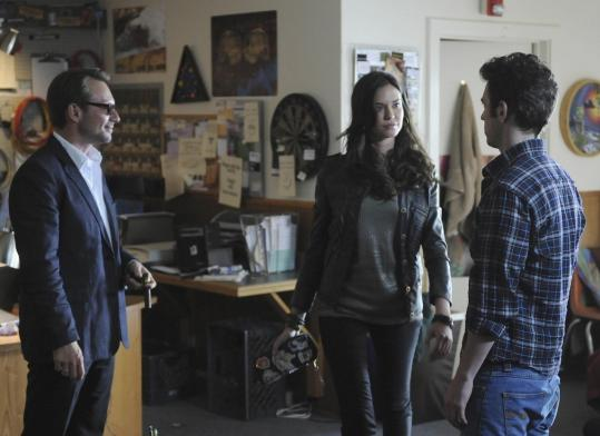 "From left: Christian Slater, Odette Annable, and Bret Harrison in ""Breaking In.''"