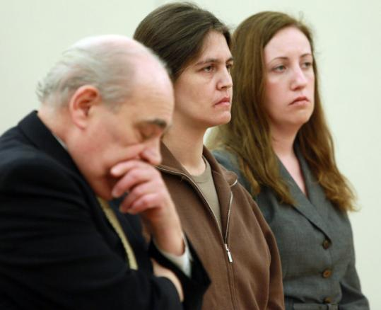 Surrounded by her attorneys, Stacey Pagli (center) was sentenced to 20 years in prison for killing her daughter, 18.