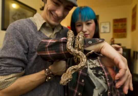 Melissa Moorhouse, with her husband, Ray, called the T's $650 cleanup after the removal of her boa unnecessary.