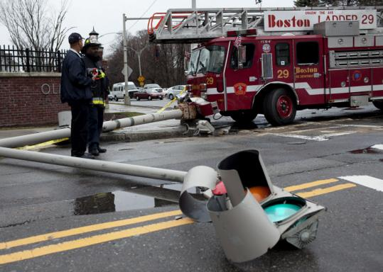 The momentum of the crash in Mattapan caused the 110-foot ladder truck to swing around and knock over a traffic light. The crash tied up traffic around Harvard and Morton streets during yesterday's rush hour.