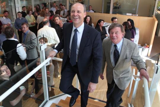Henri Termeer (right) walked through Genzyme's office in Cambridge yesterday with Sanofi's chief executive Christopher Viehbacher.