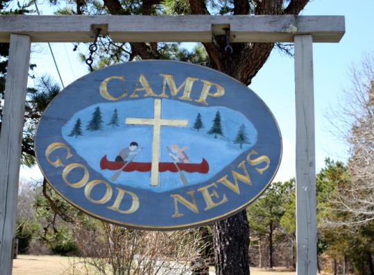 A sign at the front of Camp Good News, where Charles Devita, a longtime camp employee who served as director of the physical plant, shot himself to death Wednesday.