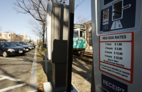 Brookline increased its game-day parking meter fee along the Beacon Street median near St. Mary's T stop to $22 for four hours.