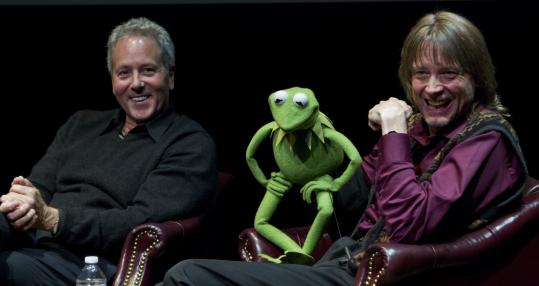 "David Hoberman (left), Kermit the Frog, and Steve Whitmire, who has ""managed'' Kermit since Jim Henson's death, at Suffolk University Thursday."