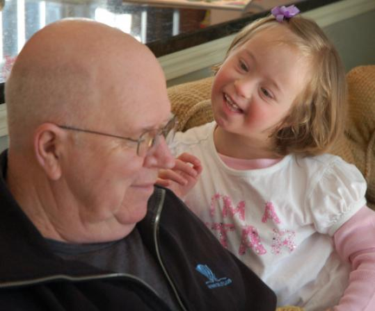 Lucy, shown with grandfather Bruce Beckham, is full of a special joy.