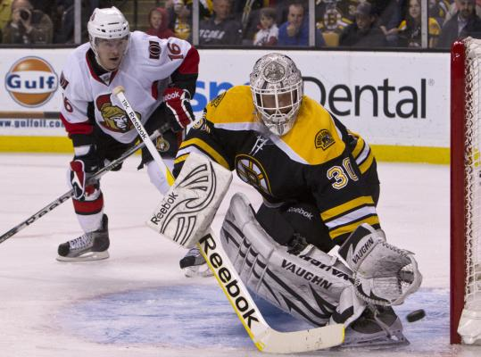 Bruins goaltender Tim Thomas makes a save while Ottawa's Bobby Butler awaits the rebound during the second period.