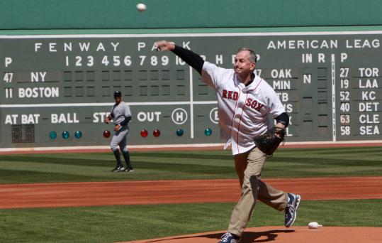 Jim Calhoun throws the ceremonial first pitch atop the Fenway mound, a place he'd been before.