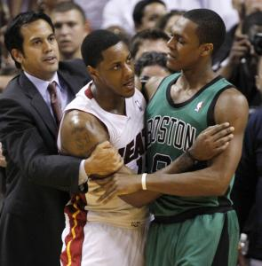 Heat coach Erik Spoelstra (left) and Celtics guard Rajon Rondo (right) restrain Miami's Mario Chalmers during a skirmish between the teams.